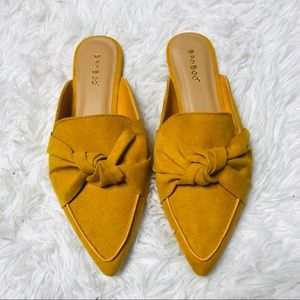 New Mustard bow front mules size 8